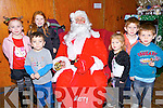PRESENTS: Children who met up with Santa at the Community Centre Ardfert at the Christmas Market l-r Khaled Renai (Ardfert), Ava Lyons (Lixnaw),Gemma Lawlor (Banna), Santa, Abigail,Ethen and Rylan O'Hara (Causeway).