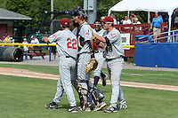 Mahoning Valley Scrappers relief pitcher Kerry Doane (22), catcher Martin Cervenka (20), and designated hitter James Roberts (48) celebrate after completing a no -hitter against the Batavia Muckdogs on September 1, 2013 at Dwyer Stadium in Batavia, New York.  The Mahoning Valley Scrappers pitching duo of Luis Gomez, Carlos Melo, and Kerry Doane tossed a no-hitter 6-0 victory over Batavia.  (Mike Janes/Four Seam Images)