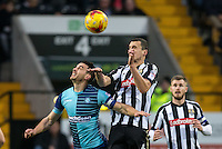 Matt Bloomfield of Wycombe Wanderers goes up with Haydn Hollis of Notts Co during the Sky Bet League 2 match between Notts County and Wycombe Wanderers at Meadow Lane, Nottingham, England on 10 December 2016. Photo by Andy Rowland.