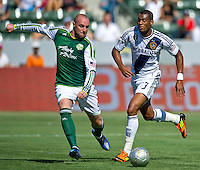 CARSON, CA - June 17, 2012: Portland Timbers forward Kris Boyd (9) and LA Galaxy defender David Junior Lopes (3) during the LA Galaxy vs Portland Timbers match at the Home Depot Center in Carson, California. Final score LA Galaxy 1, Portland Timbers 0.