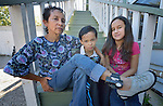 Rosaura Pineda and her children Isaac and Celeste pose at a shelter in San Antonio, Texas, on December 3, 2015. Pineda and her children fled Honduras in 2015 because of domestic violence and pressure on her children from gangs. After requesting political asylum in the United States, she was held for several days by immigration officials and then released with an ankle monitor, which she is fighting to have removed as she claims it makes her feel like a criminal. She and her children are staying in the shelter, which is run by the Refugee and Immigrant Center for Education and Legal Services (RAICES), and supported by a coalition of San Antonio churches.