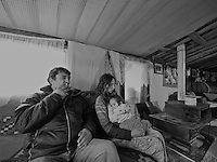 Inside a home in a Roma camp near the airport in Sarajevo, Bosnia and Herzegovina photographed on October 25, 2008..The Roma population in Bosnia-Herzegovina was heavily affected by the wars in the former Yugoslavia in the early 1990's. It is now estimated at 100,000, but there are no accurate figures, as many are not registered anywhere, either as a result of their own scepticism towards authorities, or due to difficulties in dealing with bureaucratic rules and procedures. Many Roma have no passports, no birth certificates and most importantly, no health insurance. Some aspects of their traditions, culture and lifestyle clash with accepted norms here, as happens elsewhere in Europe. As a result most Roma in the Balkans live in poverty.