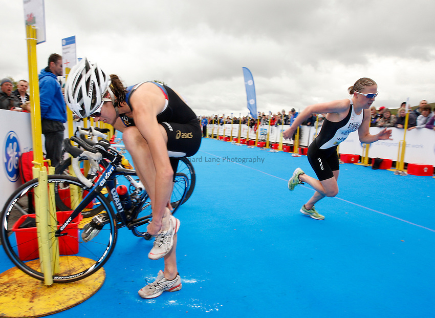 Photo: Richard Lane/Richard Lane Photography. GE Parc Bryn Bach Triathlon. 19/09/2010. Helen Jenkins in transition as Jodie Stimpson leaves just ahead during the Elite Womens' race.