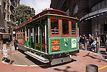A cable car changes direction at the Powell Street cable car turnaround in San Francisco, California.