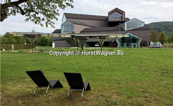 Germany, Weil am Rhein -- September 04, 2017 -- Vitra Campus, a production site (mainly furniture) and field of experimentation for architecture and design; here, the VitraHaus (by Herzog & de Meuron), housing the Vitra Home Collection, with -in front- the Elytra Filament Pavilion, an outdoor installation -- © HorstWagner.eu