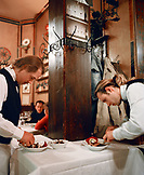 ITALY, Verona, waiters working in Antica Bottega Del Vino Restaurant