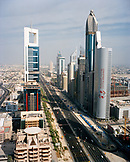 UNITED ARAB EMIRATES, Dubai, view of vehicles moving on street amid skyscrapers in downtown Dubai