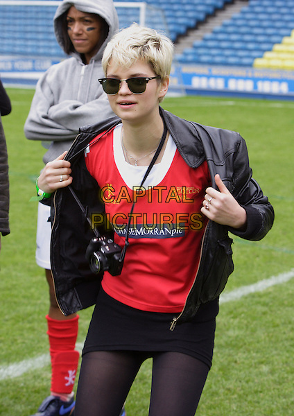 PIXIE GELDOF.Attends the Music Industry Soccer Six charity football match, in aid of the Samaritans, held at Millwall FC's New Den ground, London, England, .May 18th 2008.half length black leather jacket red top Ray Bans sunglasses short skirt camera.CAP/ROS.©Steve Ross/Capital Pictures
