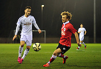 Swansea, wales. <br /> Thursday 9th March 2015..<br /> <br /> Swansea under 21s v Bristol City Under 21s<br /> <br /> Henry Jones chasing down the ball
