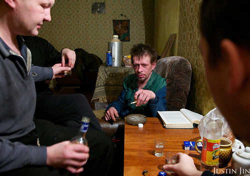 """Alexander Krashevski says he looks older, but he is only 35. A heavy alcoholic, he started drinking at school when he was 14. .Alexander was originally from Murmansk City, capital of Murmansk Province. Four years ago, he and his 26-year-old brother Yuri moved to Revda, a crumbling """"Mono-city"""" where the whole town is hanging on the fate of a single, dying factory. The local population is sharply falling, replaced in part by an influx of alcoholics like Alexander and Yuri from the expensive capital in search of cheap living..Here, they scape together 70 roubles to buy 250ml of medical spirit. ."""