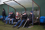 Home supporters watching the action at Ferguson Park, Rosewell, as Whitehill Welfare take on Gala Fairydean Rovers in a Scottish Lowland League fixture, which the home team won 3-0. The match was one of six arranged by the league and GroundhopUK over the weekend to accommodate groundhoppers, fans who attempt to visit as many football venues as possible. Around 100 fans in two coaches from England participated in the 2016 Lowland League Groundhop and they were joined by other individuals from across the UK which helped boost crowds at the six featured matches.