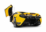 Yellow 2014 McLaren 12C supercar with open butterfly door rear view isolated sports car on white background with clipping path