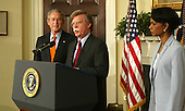 Washington, D.C. - August 1, 2005 -- John Bolton speaks during the announcement by United States President President George W. Bush of his recess appointment to be the United States Ambassador to the United Nations in the Roosevelt Room of the White House on August 1, 2005.  United States Secretary of State Condoleezza Rice is on the right. <br /> Credit: Dennis Brack - Pool via CNP