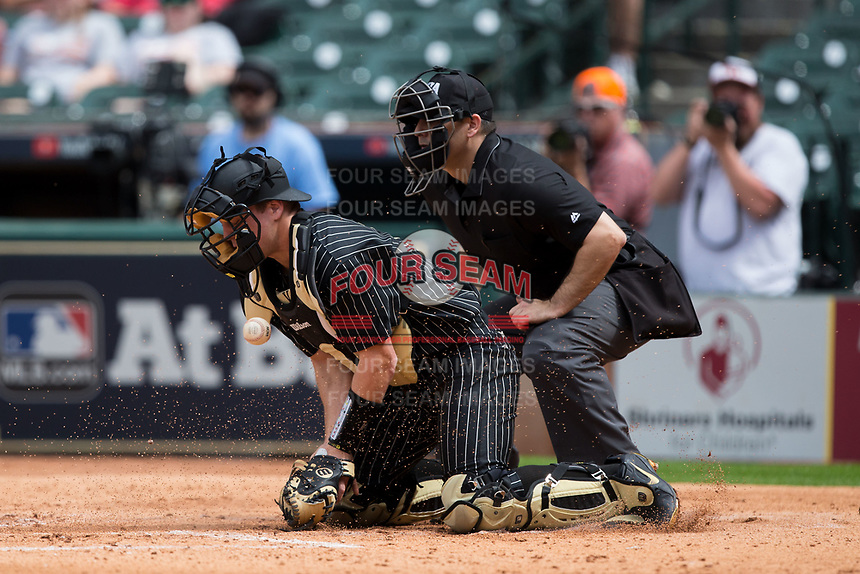 Vanderbilt Commodores catcher Stephen Scott (19) blocks a pitch in the dirt in front of home plate umpire Ryan Morehead during the game against the Sam Houston State Bearkats in game one of the 2018 Shriners Hospitals for Children College Classic at Minute Maid Park on March 2, 2018 in Houston, Texas.  The Bearkats walked-off the Commodores 7-6 in 10 innings.   (Brian Westerholt/Four Seam Images)