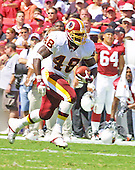 Washington Redskins running back Stephen Davis (48) carries the ball in the second quarter against the Arizona Cardinals at FedEx Field in Landover, Maryland on September 8, 2002.  The Redskins won the game 31 - 23 in Steve Spurrier's debut as head coach.<br /> Credit: Arnie Sachs / CNP