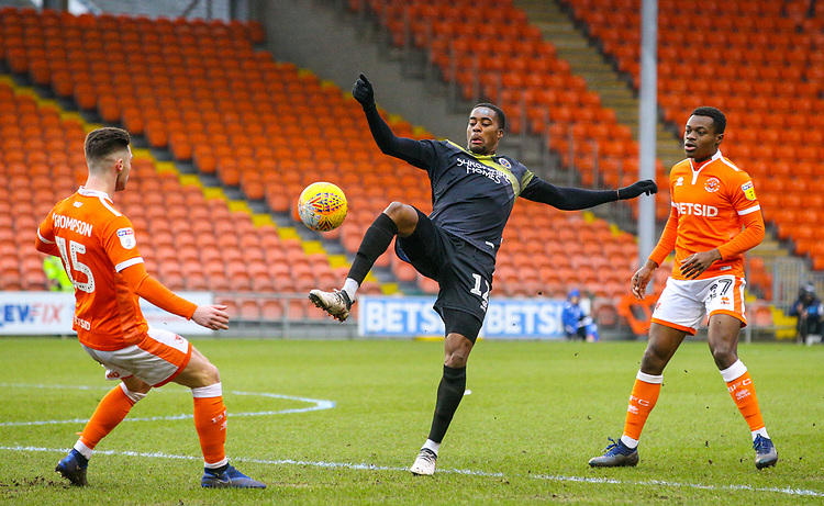 Shrewsbury Town's Fejiri Okenabirhie competes with Blackpool's Jordan Thompson and Marc Bola<br /> <br /> Photographer Alex Dodd/CameraSport<br /> <br /> The EFL Sky Bet League One - Blackpool v Shrewsbury Town - Saturday 19 January 2019 - Bloomfield Road - Blackpool<br /> <br /> World Copyright &copy; 2019 CameraSport. All rights reserved. 43 Linden Ave. Countesthorpe. Leicester. England. LE8 5PG - Tel: +44 (0) 116 277 4147 - admin@camerasport.com - www.camerasport.com