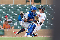 Surprise Saguaros catcher Meibrys Viloria (9), of the Kansas City Royals organization, prepares to field a throw as Travis Blankenhorn (5) slides home during an Arizona Fall League game against the Salt River Rafters at Salt River Fields at Talking Stick on October 23, 2018 in Scottsdale, Arizona. Salt River defeated Surprise 7-5 . (Zachary Lucy/Four Seam Images)