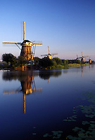 windmill, canal, Netherlands, Kinderdijk, Holland, Zuid-Holland, Europe, Mills of Kinderdijk, Working windmills along a canal in the early morning in Kinderdijk.