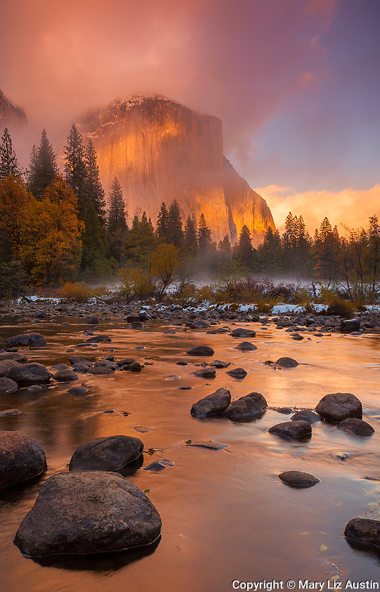 Yosemite National Park, CA: Clearing storm clouds at sunset illuminates El Capitan (7042 ft) and the Merced River in late fall.