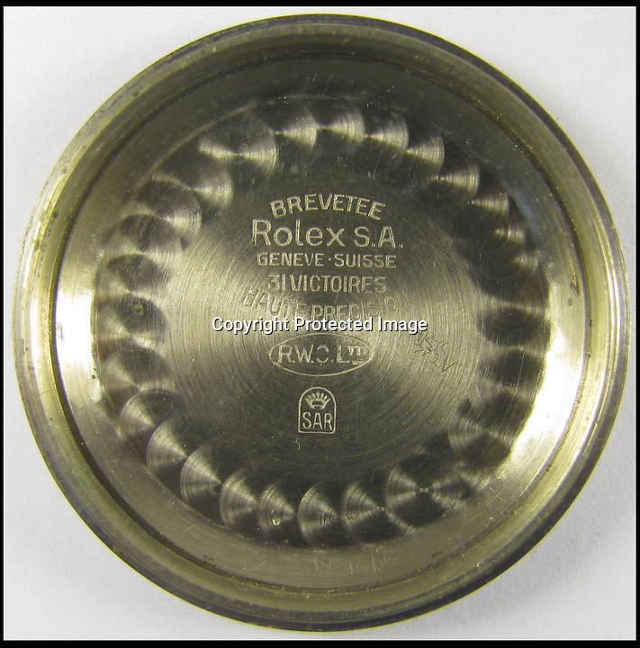 BNPS.co.uk (01202 558833)<br /> Pic: BourneEnd/BNPS<br /> <br /> ***Please use full byline***<br /> <br /> Inside of the back cover of the watch.<br /> <br /> A Rolex watch worn by a British prisoner of war during the infamous 'Great Escape' attempt is tipped to sell for &pound;30,000.<br /> <br /> Despite being held in the Stalag Luft III camp in Germany, Flight Lieutenant Gerald Imeson was still able to order and take delivery of a brand new watch in 1942.<br /> <br /> The famous Swiss watchmaker had offered all British officers one of their timepieces to replace the ones seized by the Germans and they could be paid for after the war.<br /> <br /> F/Lt Imeson helped dig the three tunnels for the audacious escape attempt of 1944.