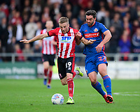 Lincoln City's Joe Morrell vies for possession with Sunderland's Will Grigg<br /> <br /> Photographer Chris Vaughan/CameraSport<br /> <br /> The EFL Sky Bet League One - Lincoln City v Sunderland - Saturday 5th October 2019 - Sincil Bank - Lincoln<br /> <br /> World Copyright © 2019 CameraSport. All rights reserved. 43 Linden Ave. Countesthorpe. Leicester. England. LE8 5PG - Tel: +44 (0) 116 277 4147 - admin@camerasport.com - www.camerasport.com