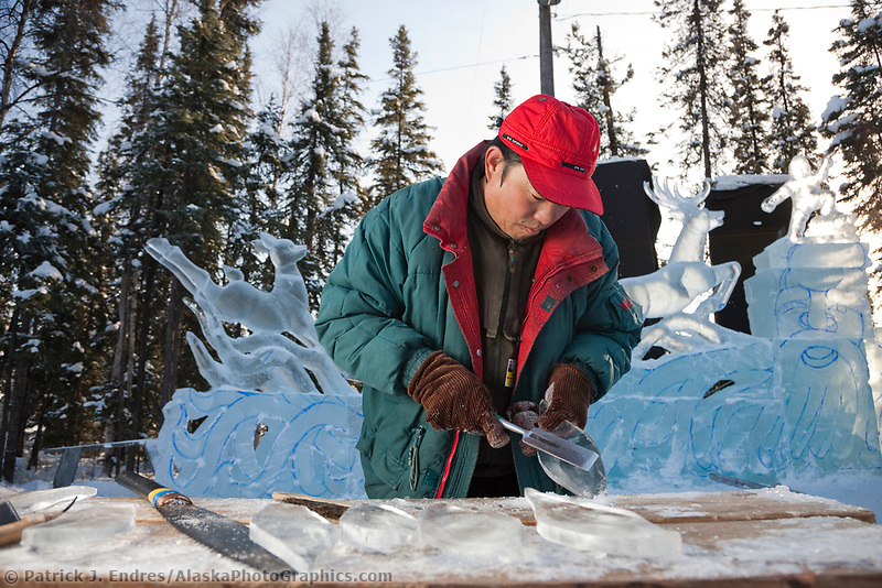 "2009 World Ice Art championships, Fairbanks, Alaska. Multi-block sculpture competition. Realistic category, titled ""The Song of the Earth"" by Chinese sculptors: Wei,Tian Zuo; Feng,Yan Long; Chang, Chun He; Li, Hai. Fen Yan Long carves ice details."