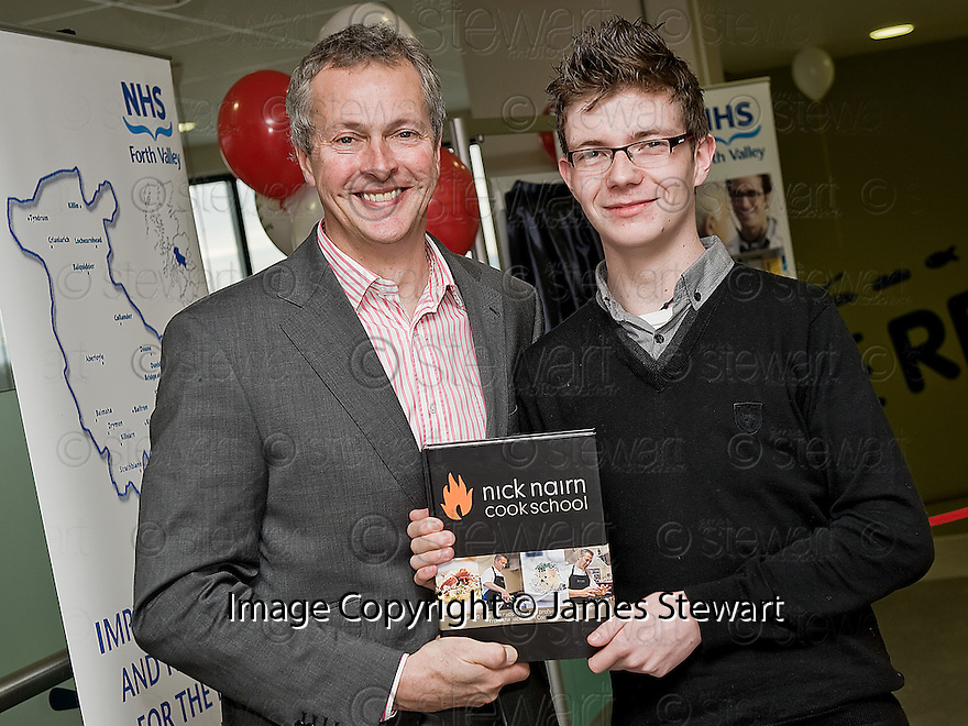 16/11/2010   Copyright  Pic : James Stewart.028_kitchen_opening  .::  SERCO ::  FORTH VALLEY ROYAL HOSPITAL RESTAURANT GRAND OPENING :: CELEBRITY CHEF NICK NAIRN PRESENTS FORTH VALLEY COLLEGE HOSPITALITY STUDENT STEVIE COUSINS WITH A SIGNED COPY OF HIS NEW BOOK AT THE OFFICIAL OPENING OF THE NEW FORTH VALLEY ROYAL HOSPITAL KITCHEN ::