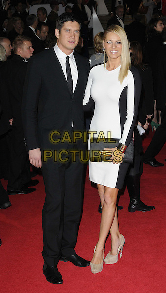 Vernon Kay & Tess Daly.'Skyfall' Royal World Film Premiere, Royal Albert Hall, Kensington Gore, London, England..23rd October 2012.full length black white dress clutch bag beige shoes suit married husband wife .CAP/CAN.©Can Nguyen/Capital Pictures.