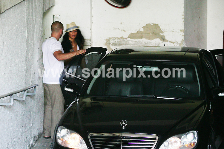 **ALL ROUND PICTURES FROM SOLARPIX.COM**.**NO SYNDICATION IN SPAIN**.**WORLDWIDE SYNDICATION RIGHTS**.The British world formula 1 champion Lewis Hamilton and His  Brazilian pop singer girlfriend from the group the Pussycat Dolls in Malaga today..This Pic:Hotel security and Nicola Sherzinger...JOB REF:7020-CS1        DATE:16_08_08.**MUST CREDIT SOLARPIX.COM OR DOUBLE FEE WILL BE CHARGED* *UNDER NO CIRCUMSTANCES IS THIS IMAGE TO BE REPRODUCED FOR ANY ONLINE EDITION WITHOUT PRIOR PERMISSION*