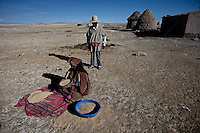A picture dated September 11, 2011 shows a Chipaya woman cleaning her quinoa in Oruro, Bolivia.  2013  was declared the international year of Quinoa by the UN.  Bolivia is the main producer of quinoa in the world.