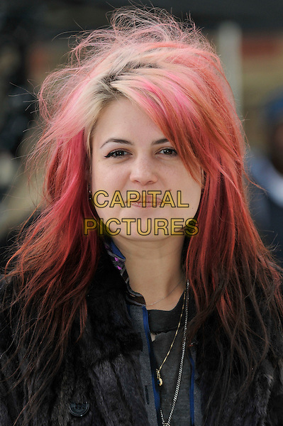 Alison Mosshart.Burberry Autumn Winter 2012 arrivals, London Fashion Week, Kensington Gardens, London, England 20th February 2012 .headshot portrait black fur coat  dyed pink hair .CAP/PL.©Phil Loftus/Capital Pictures.