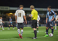 Goal scorer Alex Kacaniklic of Fulham  goes into Referee Gavin Ward's book during the Capital One Cup match between Wycombe Wanderers and Fulham at Adams Park, High Wycombe, England on 11 August 2015. Photo by Andy Rowland.