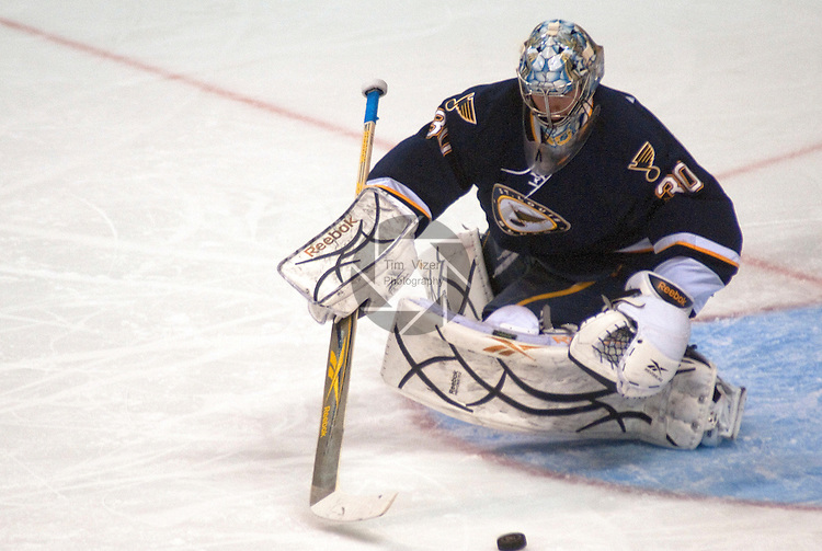February 21,  2011     St. Louis Blues goalie Ben Bishop (30) reaches for the puck in the first period. The St. Louis Blues hosted the Chicago Blackhawks on Monday February 21, 2011 at the Scottrade Center in downtown St. Louis in an afternoon game on Presidents Day.