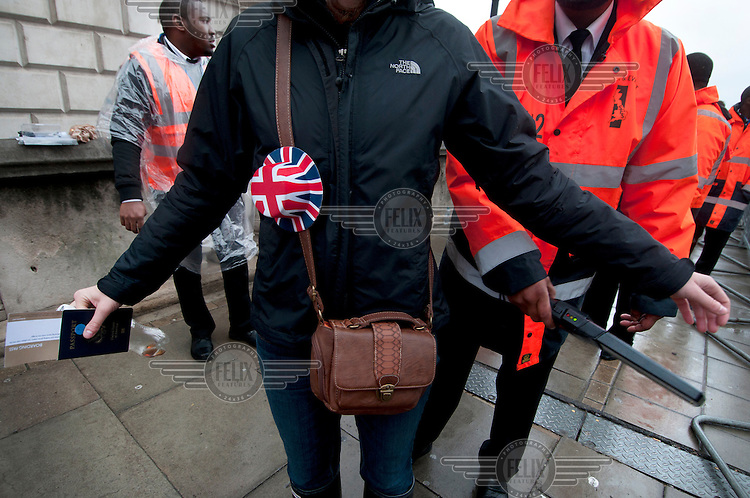 A security guard searches a woman on Waterloo Bridge during Queen Elizabeth II Diamond Jubilee celebrations in central London.