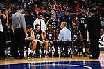 March 6, 2015; Las Vegas, NV, USA; Loyola Marymount Lions head coach Mike Dunlap instructs in a huddle against the Santa Clara Broncos during the second half of the WCC Basketball Championships at Orleans Arena.