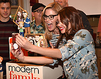 LOS ANGELES - NOVEMBER 15: Julie Bowen and Sarah Hyland celebrate Modern Family's 200th episode at the Fox Studio Lot on November 15, 2017 in Los Angeles, California. The cake was created by The Butter End. (Photo by Frank Micelotta/Fox/PictureGroup)