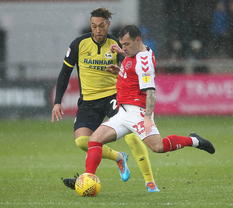 Fleetwood Town's Ross Wallace in action with Scunthorpe Utd's Kyle Wootton<br /> <br /> Photographer Mick Walker/CameraSport<br /> <br /> The EFL Sky Bet League One - Fleetwood Town v Scunthorpe United - Saturday 26th January 2019 - Highbury Stadium - Fleetwood<br /> <br /> World Copyright © 2019 CameraSport. All rights reserved. 43 Linden Ave. Countesthorpe. Leicester. England. LE8 5PG - Tel: +44 (0) 116 277 4147 - admin@camerasport.com - www.camerasport.com