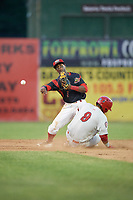 Batavia Muckdogs second baseman Samuel Castro (5) attempts to turn a double play as Oliver Ortiz (9) slides in during a game against the Auburn Doubledays on June 19, 2017 at Dwyer Stadium in Batavia, New York.  Batavia defeated Auburn 8-2 in both teams opening game of the season.  (Mike Janes/Four Seam Images)