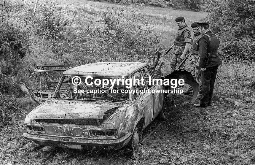 Burnt-out car belonging to Patrick Joseph Kelly, Independent Nationalist Councillor, from Trillick, Co Tyrone, who was murdered in July 1974. Ref: 19740726001...Copyright Image from Victor Patterson, 54 Dorchester Park, Belfast, UK, BT9 6RJ..Tel: +44 28 9066 1296.Mob: +44 7802 353836.Voicemail +44 20 8816 7153.Skype: victorpattersonbelfast.Email: victorpatterson@mac.com.Email: victorpatterson@ireland.com (back-up)..IMPORTANT: If you wish to use this image or any other of my images please go to www.victorpatterson.com and click on the Terms & Conditions. Then contact me by email or phone with the reference number(s) of the image(s) concerned.