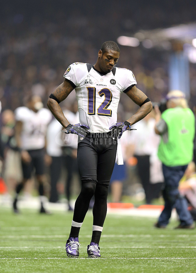Feb 3, 2013; New Orleans, LA, USA; Baltimore Ravens wide receiver Jacoby Jones (12) during the blackout delay against the San Francisco 49ers in Super Bowl XLVII at the Mercedes-Benz Superdome. Mandatory Credit: Mark J. Rebilas-