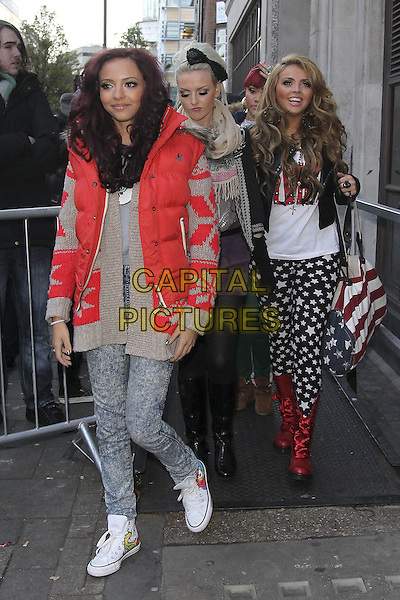 Little Mix - Jade Thirlwall, Perrie Edwards & Jesy Nelson.X Factor finalists at the studios of BBC Radio 1, London, England..December 5th, 2011.full length jeans denim red grey gray sleeveless puffa jacket jumper sweater boots stars print white black .CAP/HIL.©John Hillcoat/Capital Pictures .