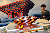 "A kid is looking at a model of China Pavilion at the Shanghai Urban Planning Exposition Center in Shanghai, China. The Chinese Pavilion is designed with the concept of ""Oriental Crown."" The traditional Chinese wooden structure element, Dougong brackets, is introduced. Its main colour is ""Gugong (Forbidden City) Red"" which represents the taste and spirit of Chinese culture. The permanent facilities including the World Expo Axis, Chinese Pavilion, Theme Pavilion, Performance Center and Expo Center of the World Expo 2010, will be completed by the end of this year..26 Oct 2009"
