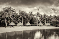 Unbrellas and chairs on lagoon beach. Bora Bora. French Polynesia.
