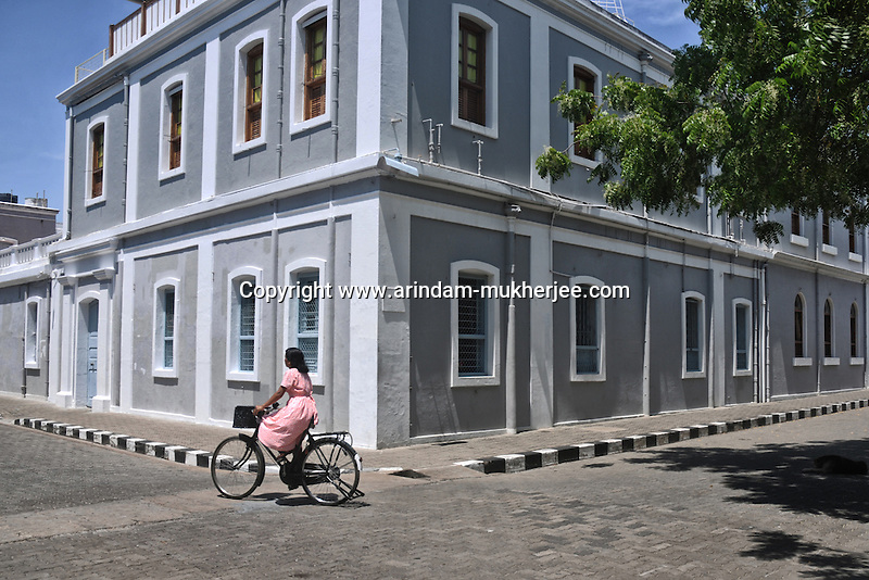 A lady on a bycycle at the French colony in Pondicherry. Arindam Mukherjee