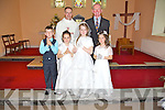 Children from Flemby N.S. Ballymacelligot, pictured with their teacher Maurice Laide and  Fr. Pat Crean-Lynch P.P. at their First Holy Communion held in The Church of the Immaculate Conception, Ballymacelligot on Saturday. Front l/r Da?ire McGovern, Edele Browne, Laura O'Shea and Michaela Marshall.