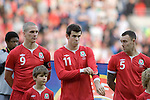 Gareth Bale putting on his black poppy armband..ahead of the Wales v Norway Vauxhall international friendly match at the Cardiff City Stadium in South Wales..Editorial use only.