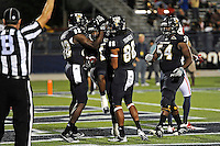 12 November 2011:  FIU wide receiver Willis Wright (1) celebrates his second quarter touchdown with wide receiver Dominique Rhymes (82) and wide receiver Jacob Younger (88) as the FIU Golden Panthers defeated the Florida Atlantic University Owls, 41-7, to win the annual Shula Bowl game, at FIU Stadium in Miami, Florida.