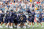 Yale players celebrate the victory as Yale defeats UAlbany 20-11 in the NCAAA semifinal game at Gillette Stadium, May 26.