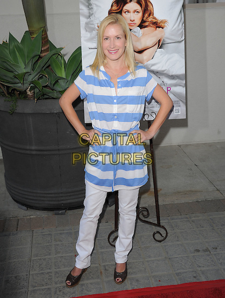 """Angela Kinsey .attends the L.A. Premiere of """"A Little Help"""" held at Sony Pictures Studios in Culver City, California, USA..July 14th, 2011.full length white blue striped stripes top hands on hips grey gray trousers.CAP/RKE/EML.©EML/RockinExposures/Capital Pictures."""