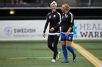 Seattle, WA - Saturday Aug. 27, 2016: Megan Rapinoe, Merritt Mathias prior to a regular season National Women's Soccer League (NWSL) match between the Seattle Reign FC and the Portland Thorns FC at Memorial Stadium.